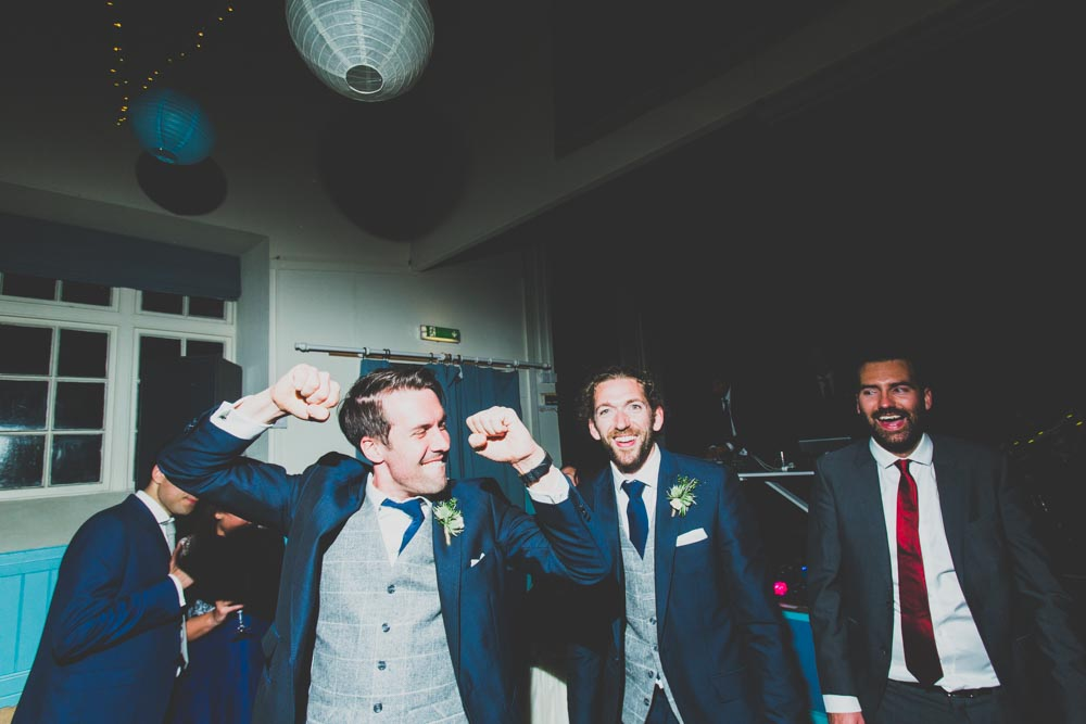 Documentary Wedding Photographers South Wales | The grooms party having fun at the wedding reception