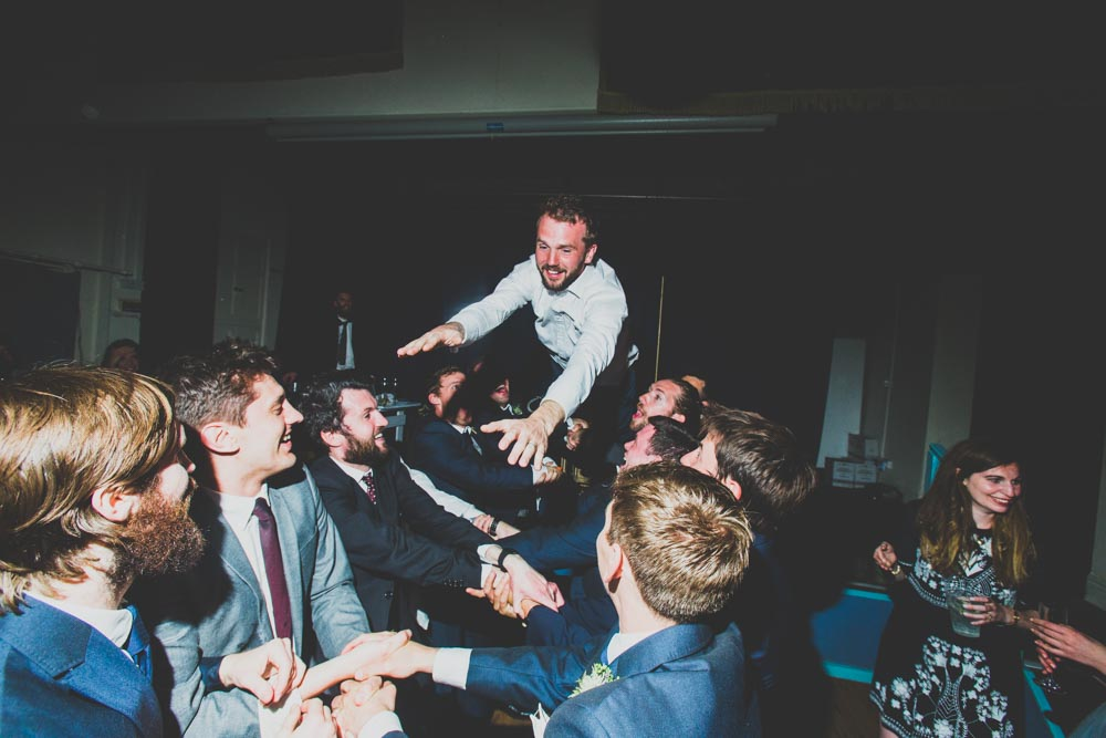 The groom stage diving at his wedding | Alternative south wales wedding photographers