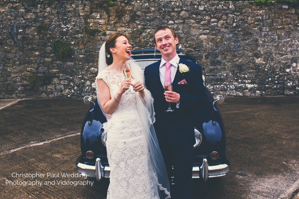 Catherine and Connor having 5 mins alone after their wedding ceremony at St Donat's Castle ; Atlantic College South Wales