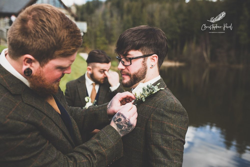 The Groom getting his button holes in place before the wedding ceremony