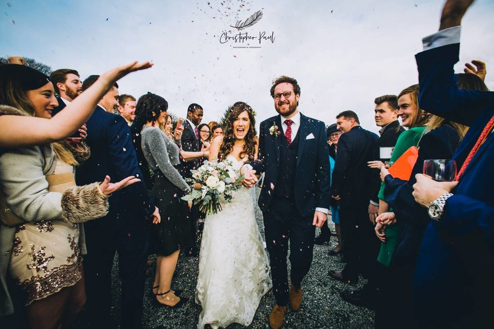 A happy couple covered in confetti in Cornwall what else can you want!  -Trevenna Wedding Venue Cornwall