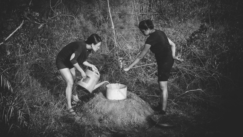 Beauty and Tintu, planting their first ever tree in the Forest.