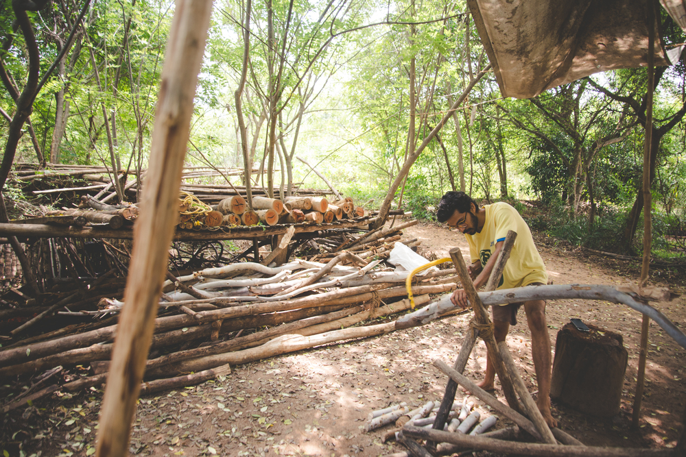 Aalaap, sawing firewood for the kitchen.