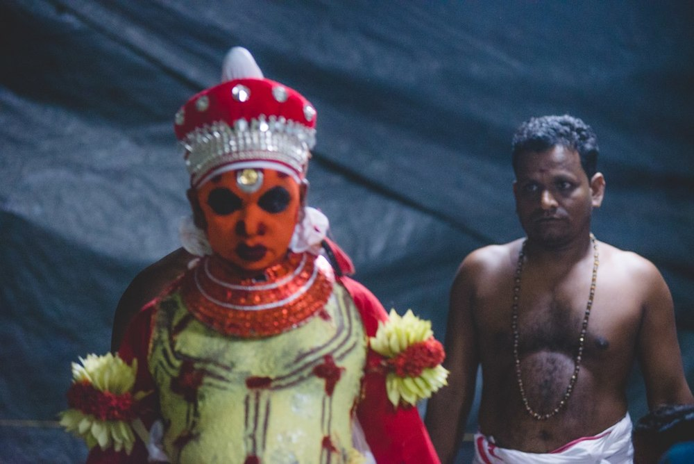 The make-up artist inspecting his work. This performance of Theyyam was on a relatively smaller scale that took place in the tiny village of Azhikode. The make-up wasn't as detailed as in most other Theyyam performances that happen in other major temples.