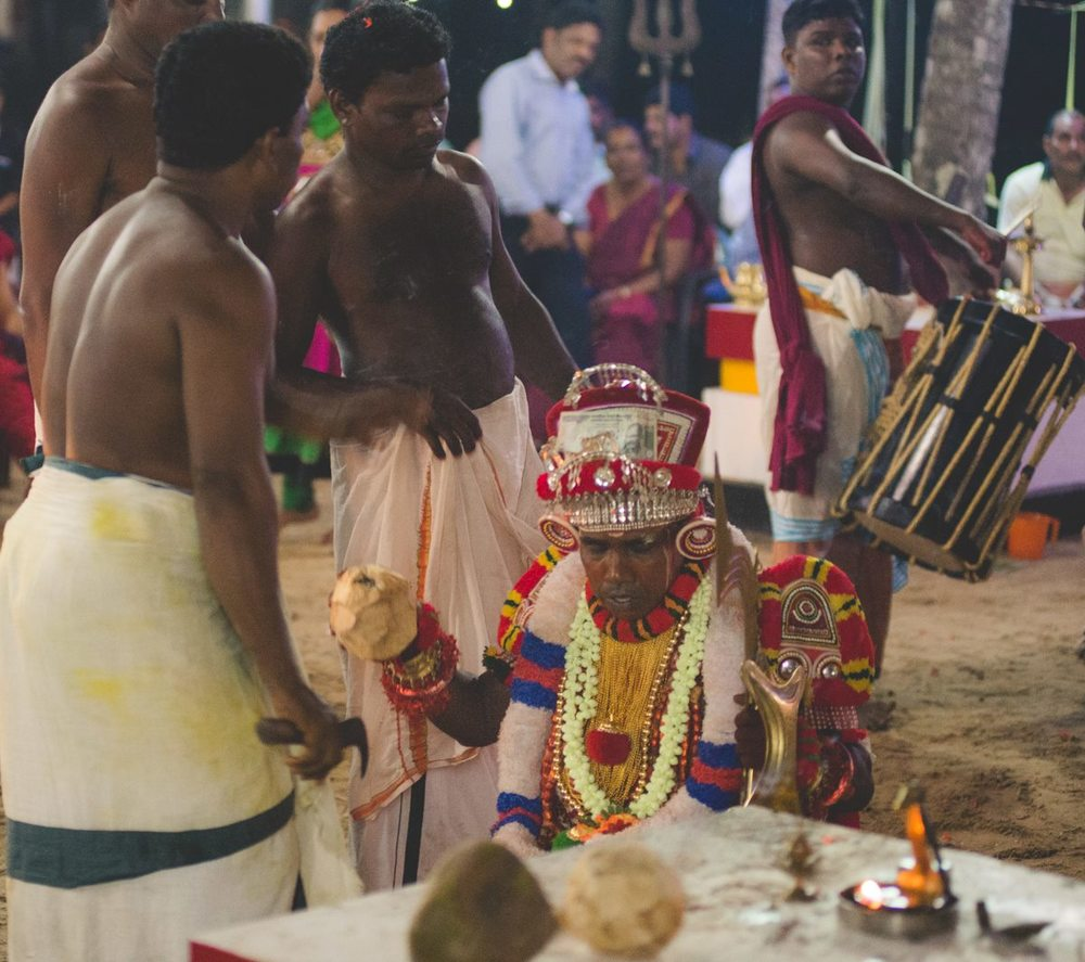 The performer descends into a trance during the performance. The exhausted performer is offered coconut water as an offering.