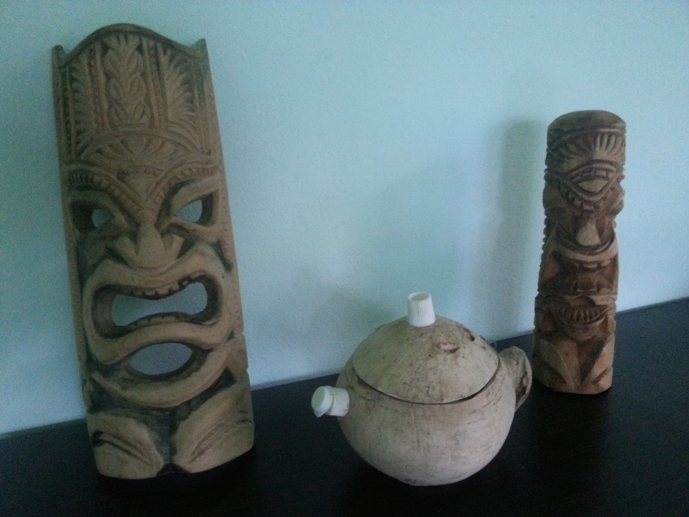 Pic: My Tongan woodcarvings, plus a coconut shell teapot featuring toothpaste lids, that a local man gave to me