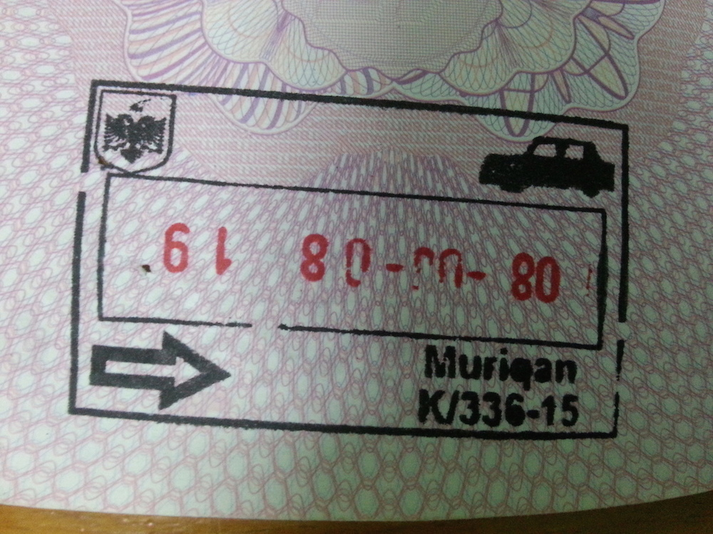 "Pic: Entry stamp at Muriqan, Albania. Albania is known as the ""Land of Eagles"", hence the national insignia in the top left corner."