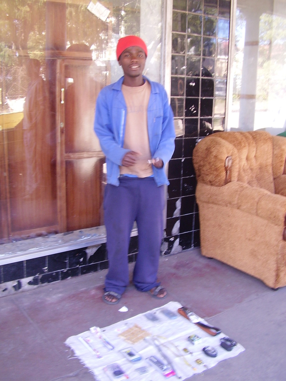 Pic: Young man selling mobile phones and accessories, Bulawayo.