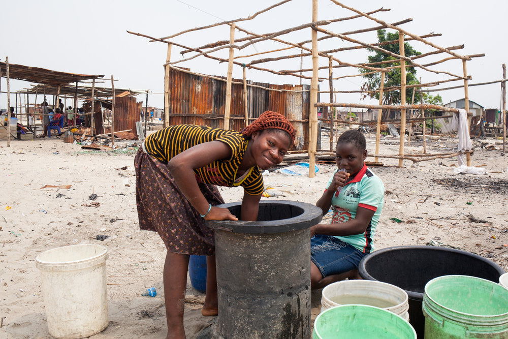 Residents access water from community wells.