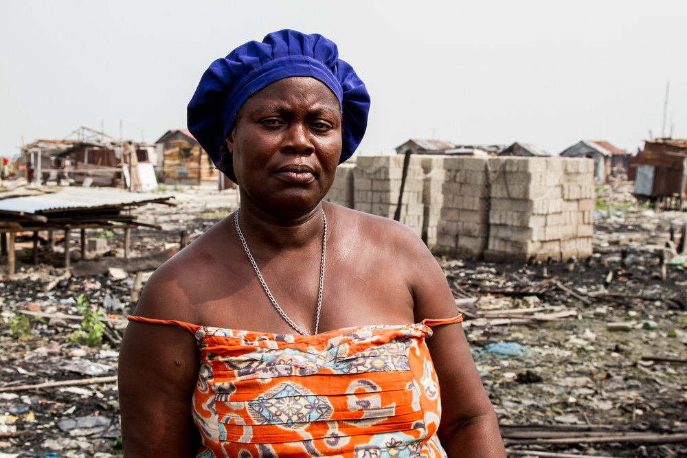 Rosaline Esinsu is a leader in the Celestial Church in Otodo Gbame and also sells smoked fish and is a community leader. She hasn't seen her husband since he fled into the water following the evictions.