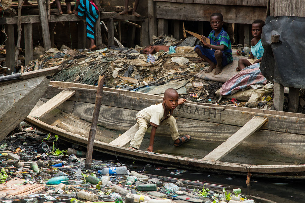 Rubbish litters the waterways where children play and families live. Much of the rubbish is collected an used as an innovative foundation for land reclamation.