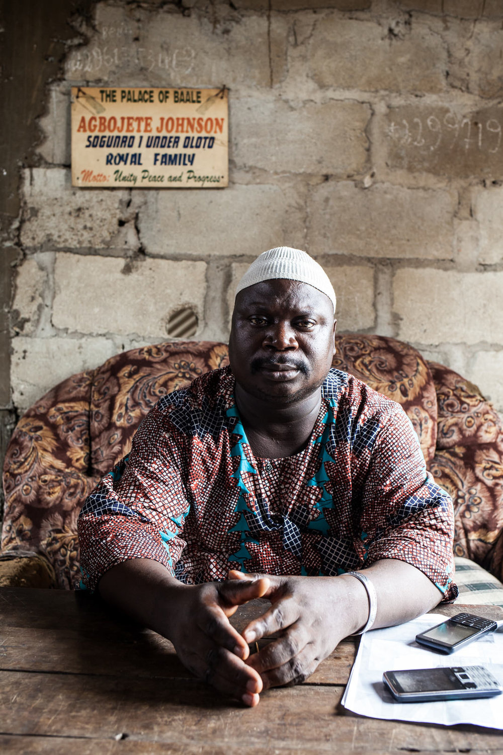 "Agbojete Johnson is the Baale, or 'King', of Sogunro. He was instrumental in sending boats to Otodo Gbame to collect evictees and bring them to Sogunro.  ""It was terrible"", he recounts, ""the people really suffered. Even as big as this community is, there is no government hospital. They don't care about us."""