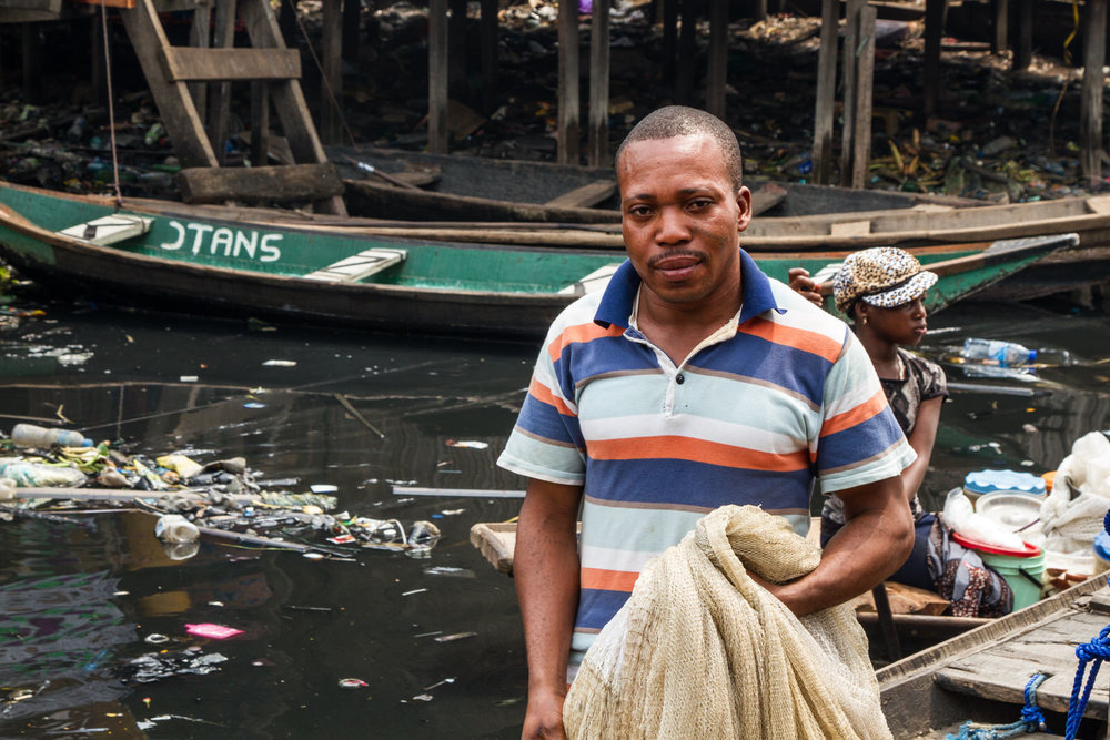 This fisherman is from the community, and lives close to Gerard. He invited his sister, who had lived in Otodo Gbame during the evictions, to come and stay with him when her house was demolished.