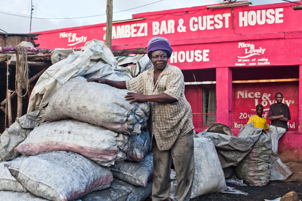 Charles Odugu  sells charcoal in Kondele market where he has a strong network of regular customers. Charles worries about the future as there are fears of relocation.