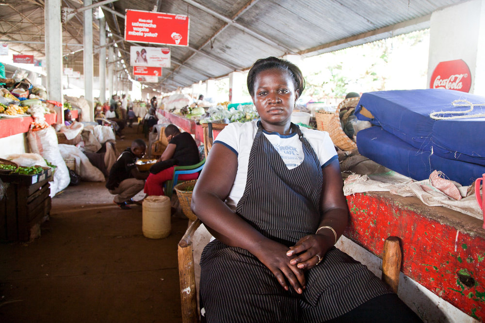 Florence Auma Othuon  is a widow living with her three children. She became a trader when her mother got sick and had to help her in the market. On the subject of the upgrading of the market, she agrees that improvements are necessary but there needs to be adequate temporary space within the town.  Her aspirations are for her children to get good jobs, such as being a doctor.