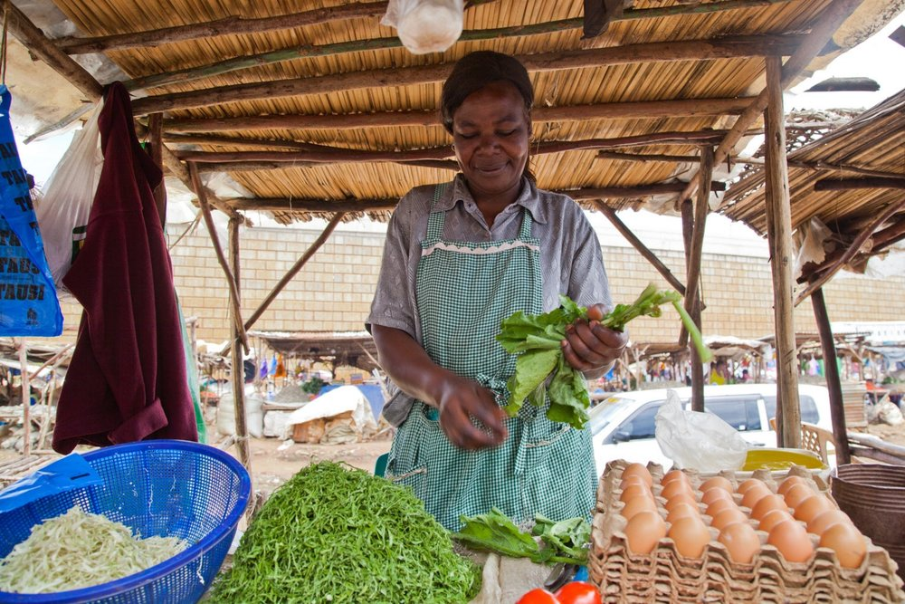 Mildred    is a widow living in Kisumu with one child. Mildred was able to establish a successful business until 2012 when she left Kisumu in order to take care of her son. After her son's death, Mildred returned to Kisumu where her friend helped her secure a space in the market.     Mildred has successfully rebuilt her trading networks at Kondele, and is now the secretary of her savings and loans group. Her aspirations are to own a shop and to build a home for her and her daughter.