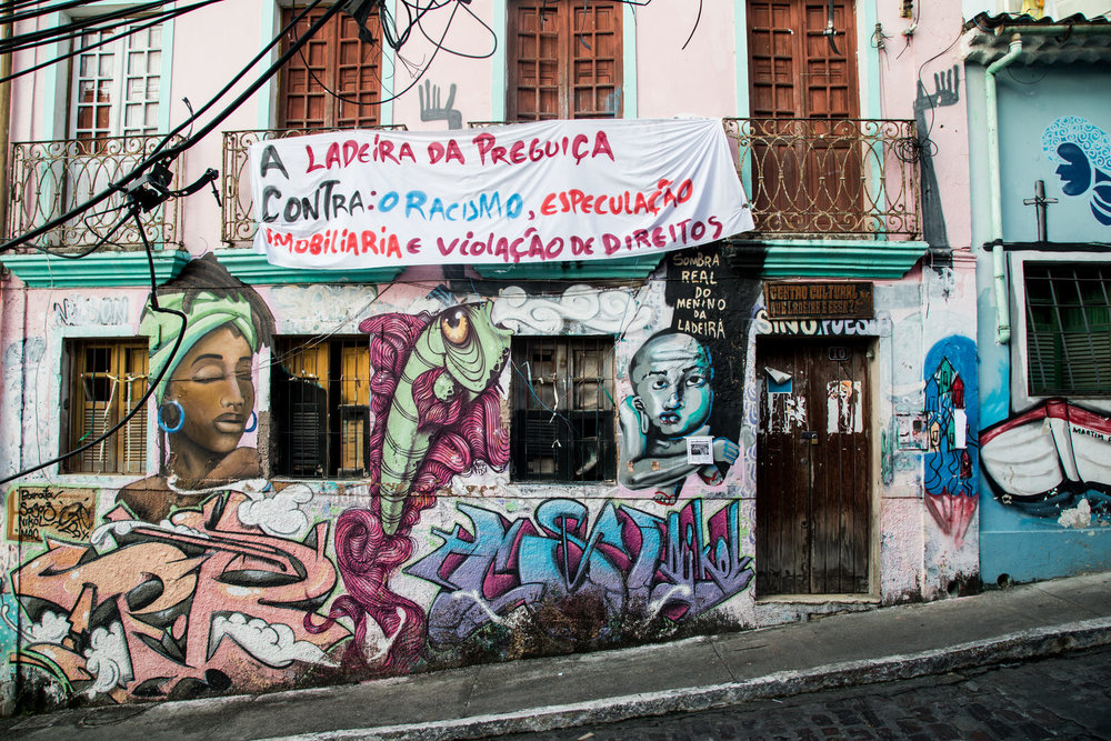 "Close to the  cidade baixa  is the commmunity of  Ladeira da Preguiça ( literally ""Slope of Laziness"") which is made up of narrow streets and vacant warehouses, and has over time lent itself to organised crime and, most recently, to drug-trafficking."