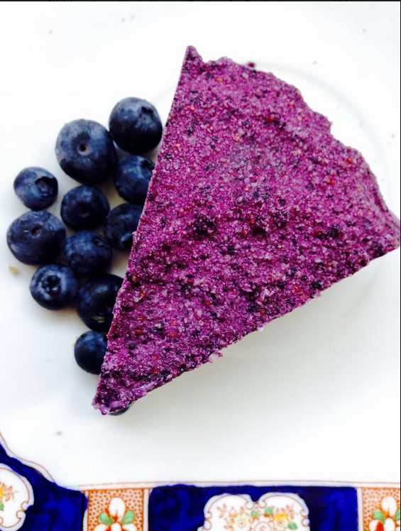 """Raw Vegan Blueberry """"Cheesecake""""   How good is this colour ?? Blueberries are one of my favourite in the berry family. They are so delicious, versatile and high in antioxidants. Fun fact -they are also one of the national foods of Finland. Try out this super easy and delicious recipe - it's a perfect quick afternoon snack when you just need that """"little something"""".  Firstly - soak 2 cups raw cashews for a couple of hours, until soft.  In a food processor, combine - 1 cup of sunflower seeds, 1.5 cups pitted dates, 1 tbsp vanilla paste and 1 tsp black sesame seeds. Whizz together until it resembles crumbs. Press into a shallow 20 cm pan. Refrigerate.  Process - the soaked cashews, 2 cups blueberries (if using frozen - allow to soften a little), 1/2 cup of maple syrup, 1 tbsp lime juice, 1 tbsp favourite nut butter (I used almond butter) and a pinch of salt. Blend until smooth and a deep, rich purple colour. Pour over the crust and spread evenly.  Freeze for about 3 hours. Allow to sit for a few minutes before cutting. Store in the freezer.  Delicious served with fresh blueberries and coconut yogurt. Be inspired by nature's colours !"""