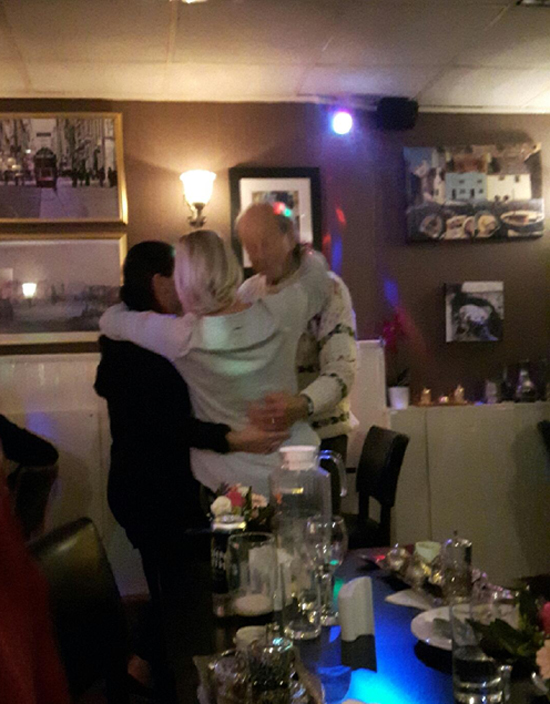 Alan in Greek restaurant dancing with friends