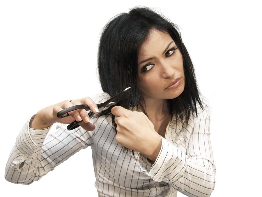 bigstock-Woman-Cuting-Her-Hair-2158258.jpg