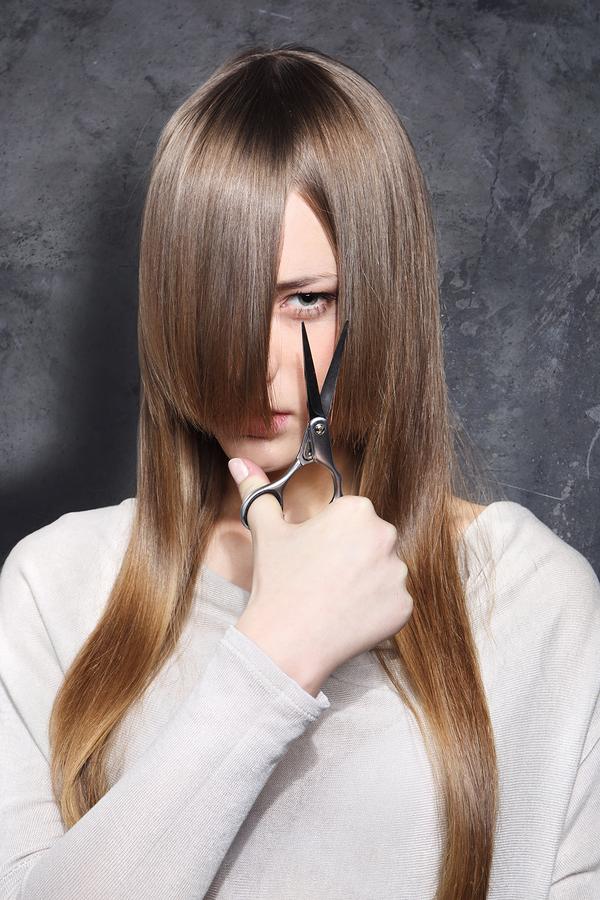 bigstock-Girl-with-scissors-42840067.jpg