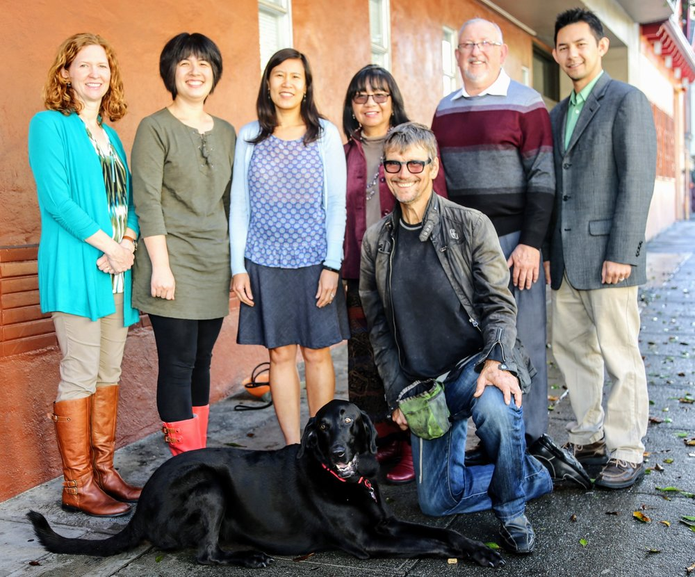 Jubilee staff, volunteer Spanish interpreters and Mallie, our adopted office dog