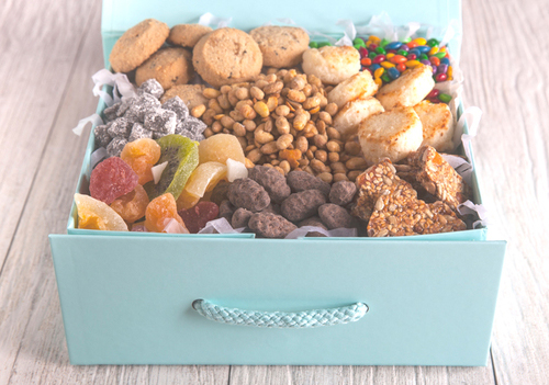 Snacks are placed inside a beautiful blue box.