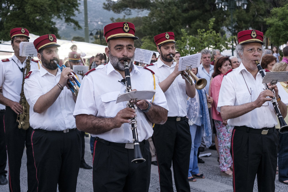 The town band at Penteli playing in the procession for Panigyri on Penteli mountain, Greece.