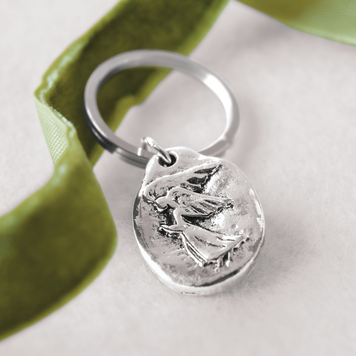 Carry our ethereal Guardian Angel keepsake as a daily reminder of peace, guidance and grace. Silver key ring and hand made charm come beautifully presented in a hand crafted wood crate with ribbon.