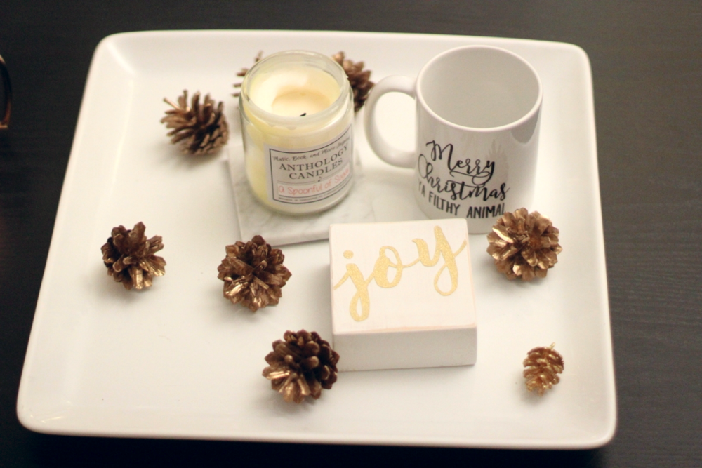Can't forget coffee table decor!  Gold Pine Cones // Joy Block