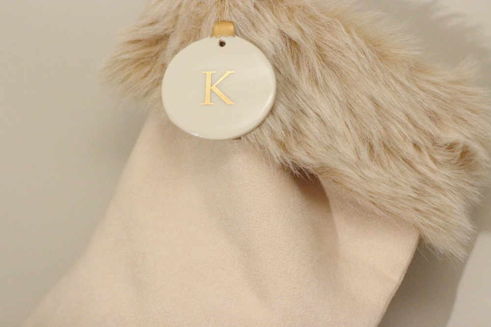 Stockings // Ornament   And can we talk about these stockings?! Again, this season's fur obsession works even with stockings.  I loveee these.  I added a personal touch with a monogram ornament! Love all the gold and ivory :)