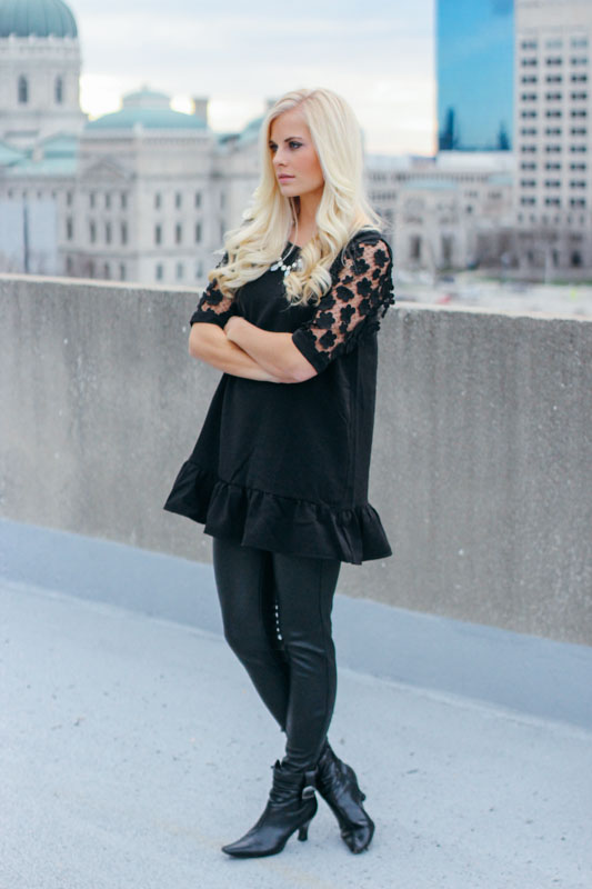 I love an all black party look. The edgy leather pants are a nice contrast with this delicate top.