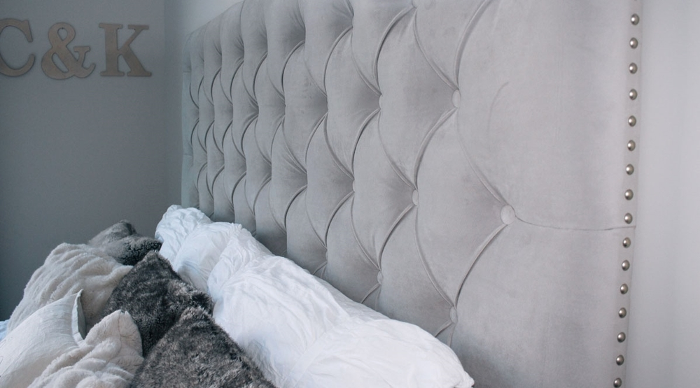 Love the studded detailing on this headboard!