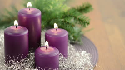stock-footage--advent-with-purple-advent-candle-burning-with-wreath-and-silver-decoration