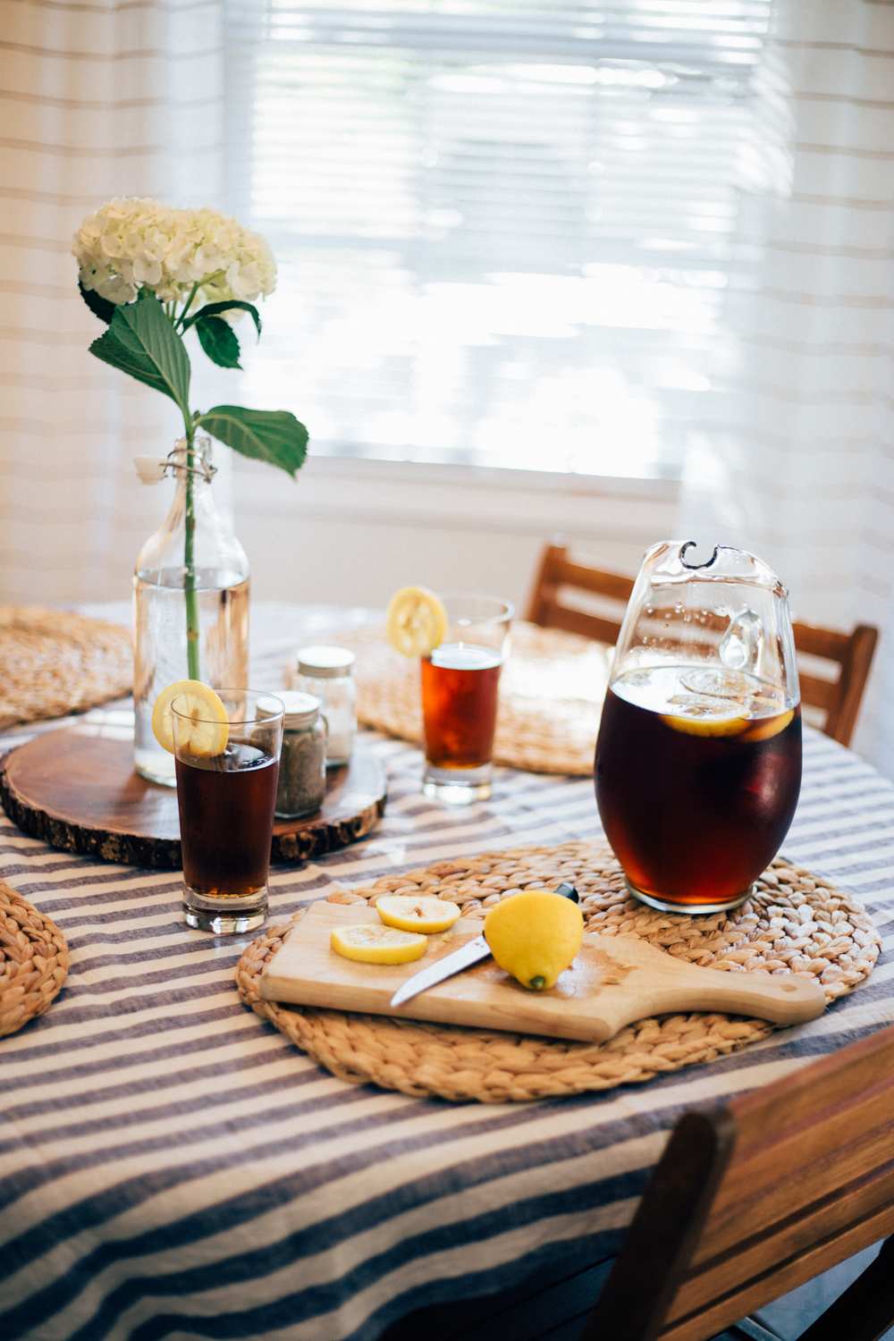 A linen tablecloth, fresh hydrangeas, and lots of sweet tea and lemons make for a perfect lazy summer afternoon.