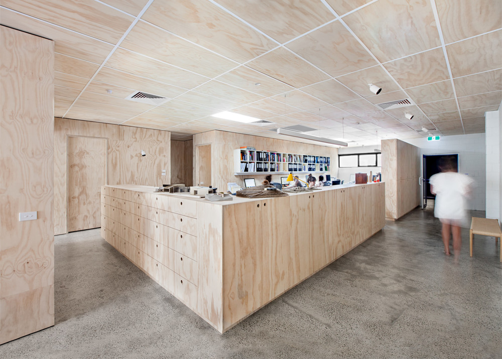 The shared 'Blackwood Street Bunker' workplace retains the shell and reuses parts of the original fit-out. The inclusion of plywood creates form and texture, reflecting the interplay of architectural elements within the space.   Images courtesy of Clare Cousins Architects. Photography by Lisbeth Grosmann.