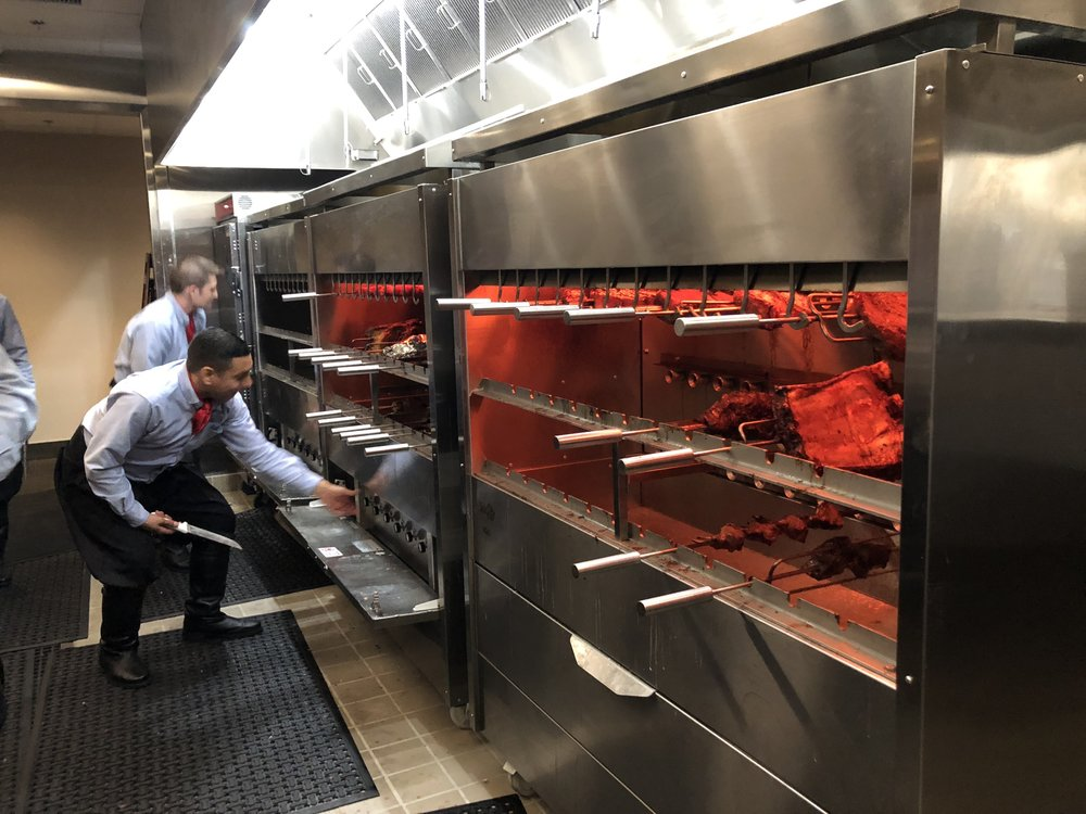 Gaucho's prepare to take the choice meats to the guests.