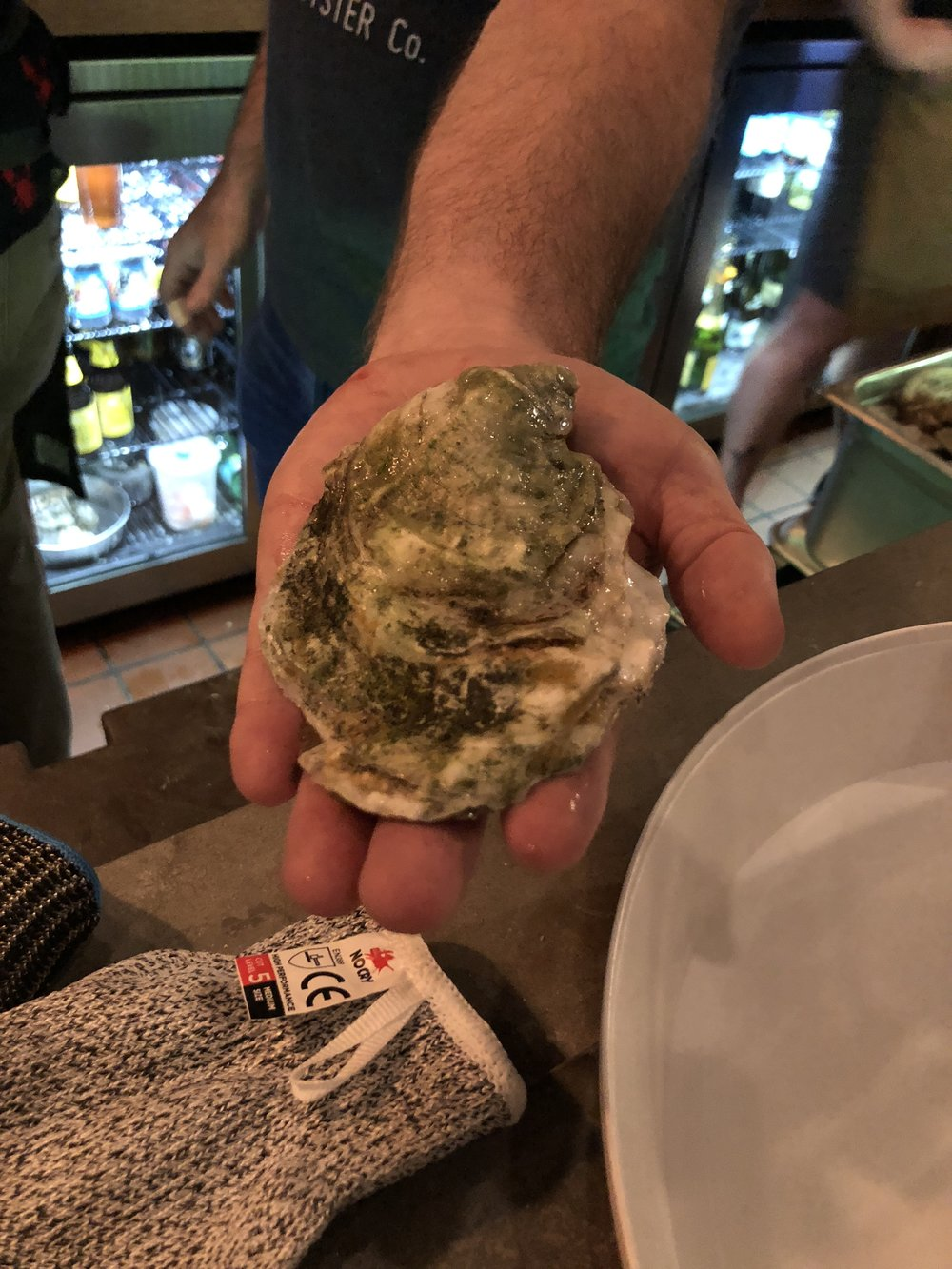 Chef Dennis Marron shows off one of the Oysters from Merchant Oyster