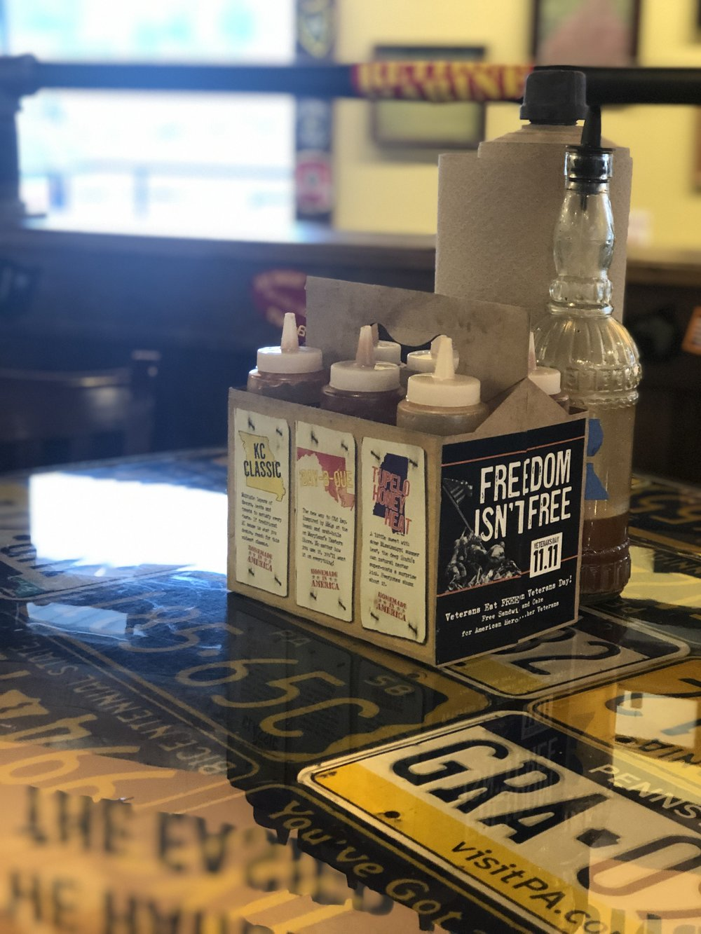 The Sauce Bottles At Mission BBQ