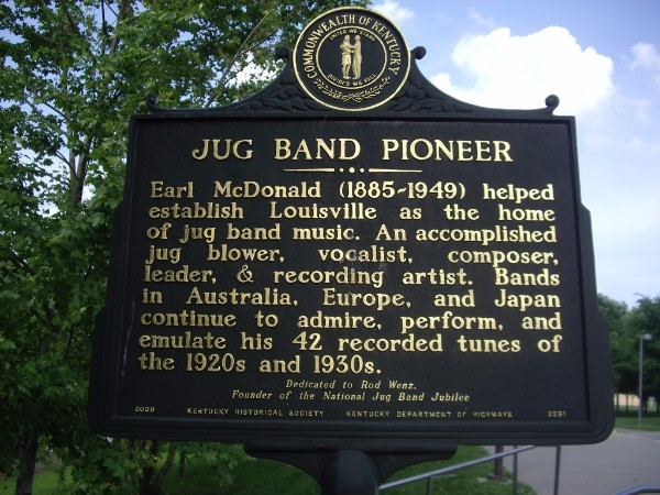 Historical marker commemorating jug band leader Earl McDonald, dedicated to the founder of the Jubilee and placed directly behind the Jubilee stage at the Brown-Forman Amphitheater.