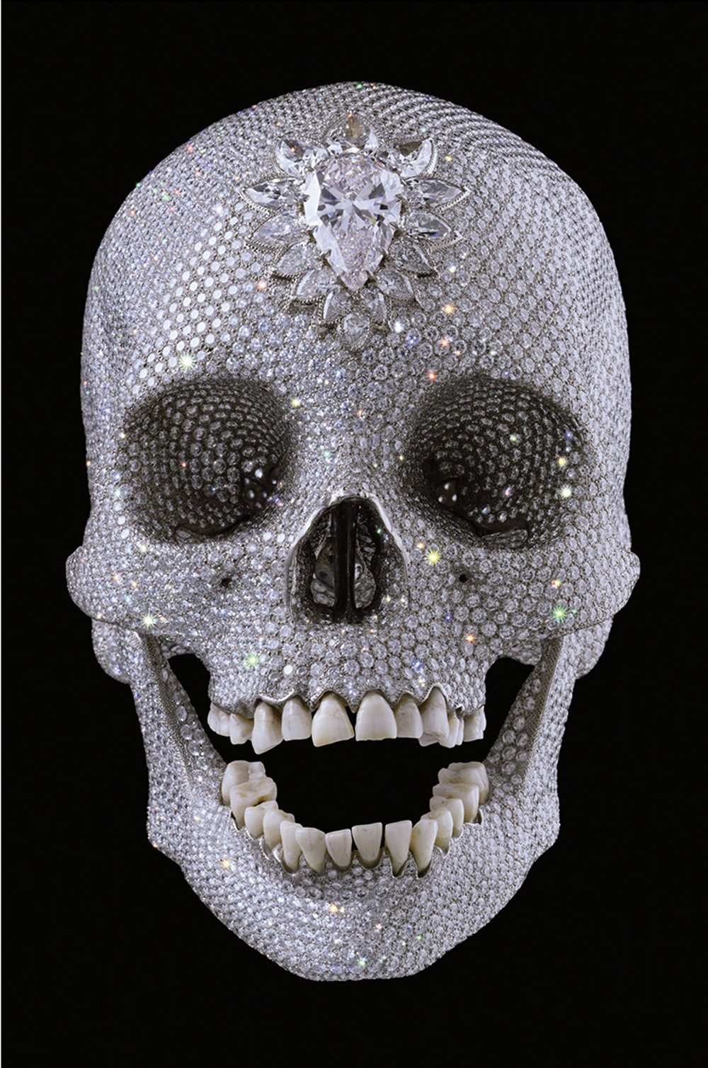 Q, Why is Damian Hirst's diamond encrusted skull, widely considered an object of ultimate desire, now worth much more than the sum of its parts?