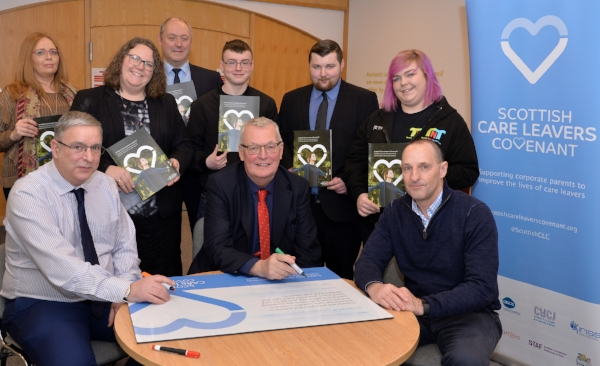 Pictured: Council Leader Jim Logue and Councillor Willie Goldie sign the Covenant with Kenny McGhee from the Care Leavers Alliance.