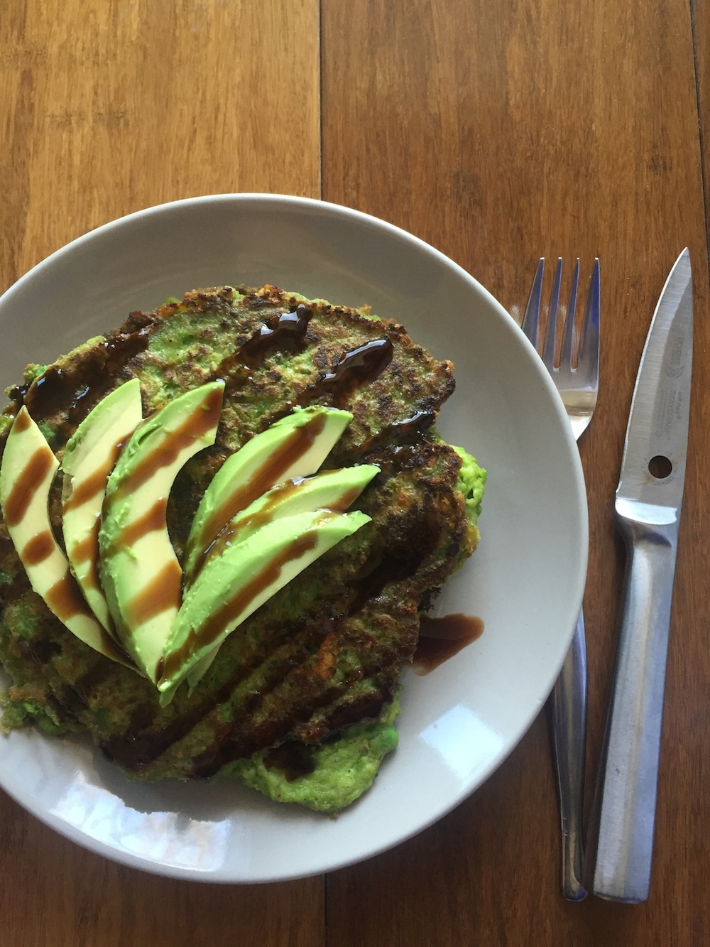 Green pea pancakes with avocado and balsamic glaze