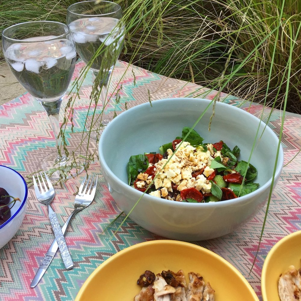 Greek-style salad, enjoyed as part of a summer dinner picnic.