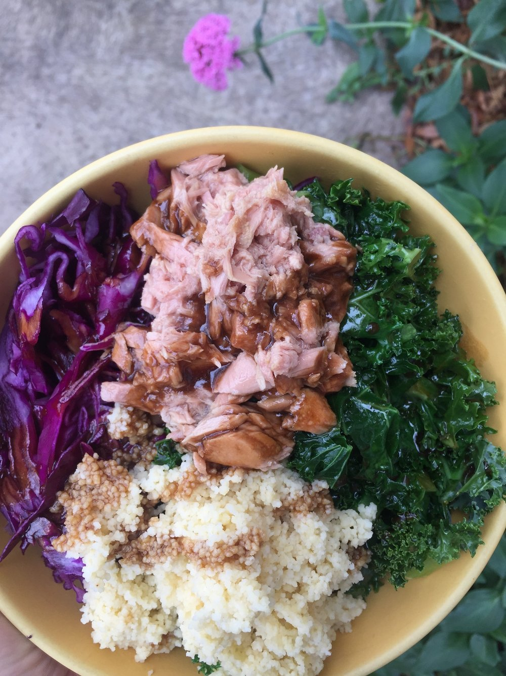 Tasty tuna nourish bowl with cous cous and sauteed kale.