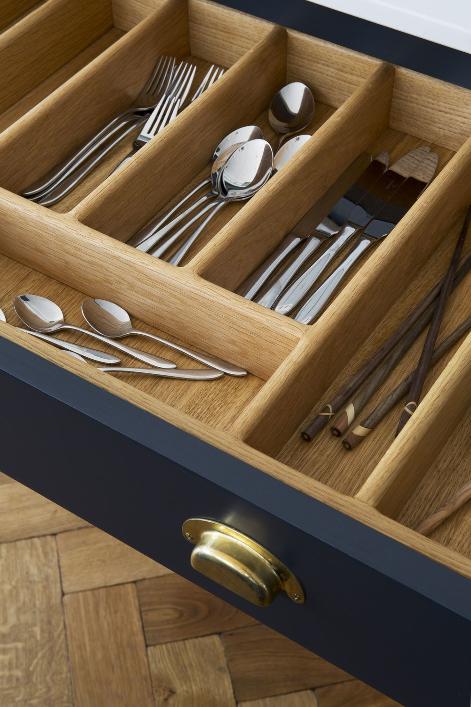 brass handles, birch drawers, blue, cutlery, kitchen space