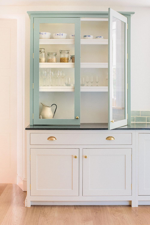 handmade cupboards, blue, brass handles, bespoke design, camberwell