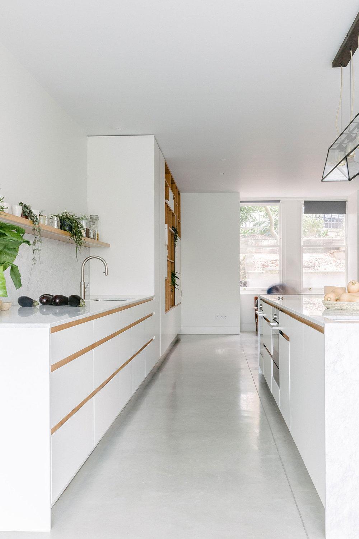 clean lines white bespoke kitchen london