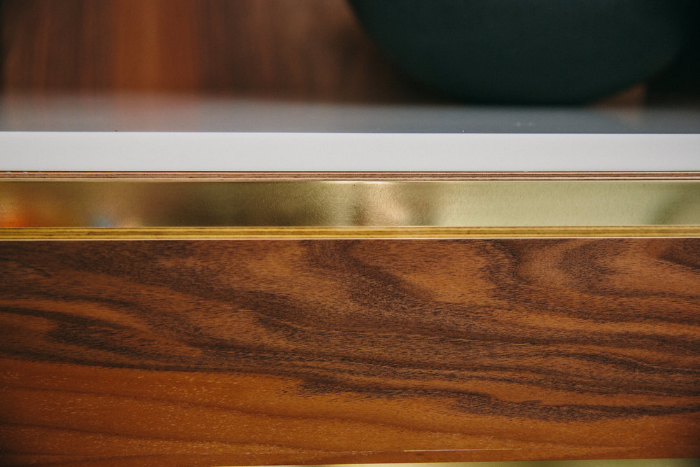 brass detail worktop surface bespoke kitchen