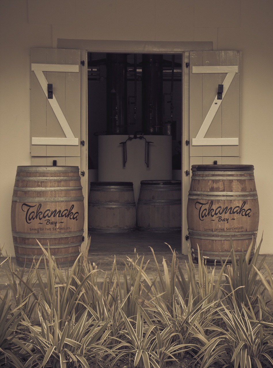 Takamaka rum barrels outside door